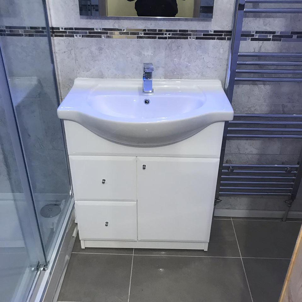 white sink and cabinets